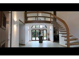 Entrance And Staircase To  Two Master Suites