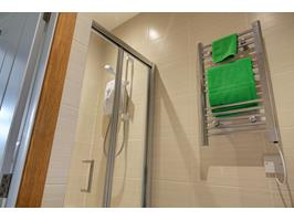 Heated Towel Rail And Electric Shower